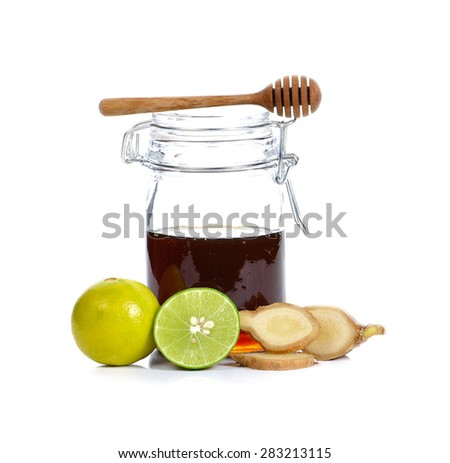 honey, lemon and ginger on white  background. - stock photo
