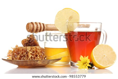 honey, lemon, honeycomb and a cup of tea isolated on white - stock photo