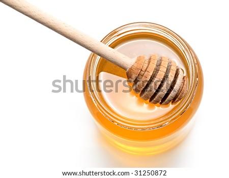 Honey on white Background with wood stick - stock photo