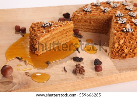 Honey pie on a wooden cutting board with decoration