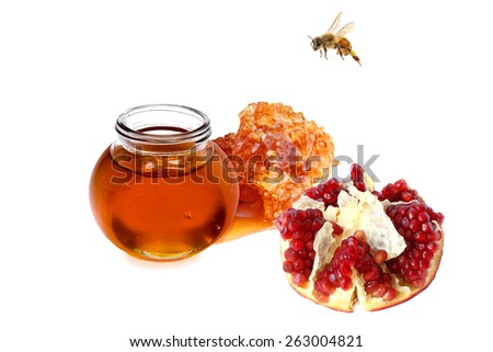 Honey, pomegranate and bee. Isolated on white - stock photo