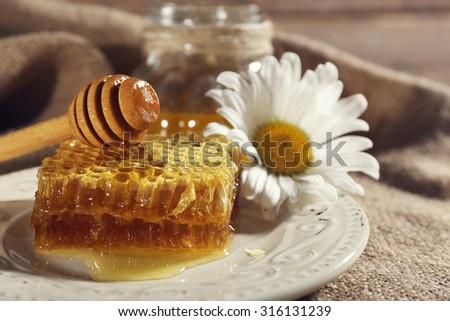 Honey products on fabric background - stock photo