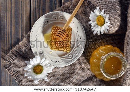 Honey products on wooden background - stock photo