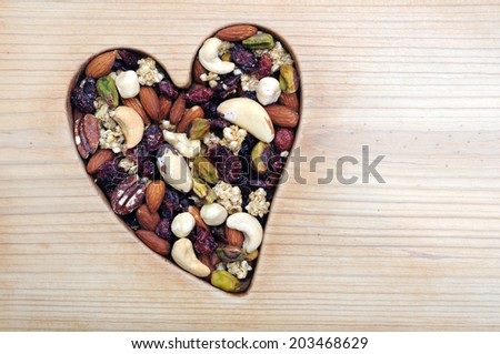 honey roasted nut in heart frame for Valentine Day - stock photo