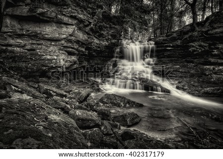 Honey Run falls in central Ohio in black and white. Pretty little secluded waterfall in a hidden gorge.