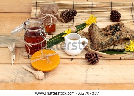 Honey variety with honeycomb and honey in a jar with beeswax