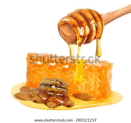 honey with hazelnuts and almonds isolated - stock photo