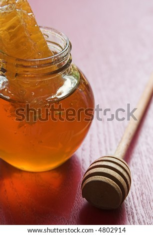 Honey with honeycomb and spoon