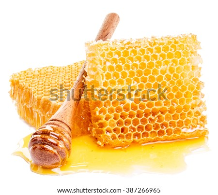 Honeycomb and honey drizzler on a white background.  High-quality picture. - stock photo