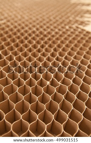 Honeycomb cardboard cells. Geometric background with copy space. Recyclable craft paper.
