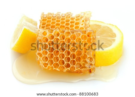 Honeycomb close up with lemon on the white - stock photo