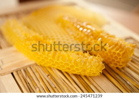 Honeycomb in a beehive. Honey before preparing to using. Organic, healthy food. bee, bees, natural environment, nature, agriculture, countryside, home-made food. - stock photo