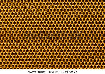 Honeycomb texture,Yellow mesh fabric surface , Honeycomb mesh fabric surface , honeycomb fabric , honeycomb shallow depth , Honeycomb shallow - stock photo