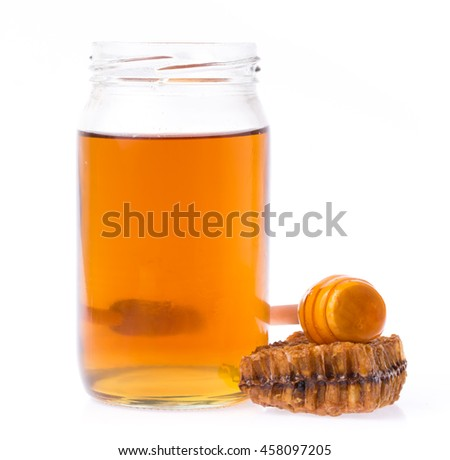 Honeycombs with bottle of honey and wooden dipper isolated on white background