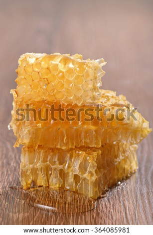 honeycombs with honey on wooden background - stock photo