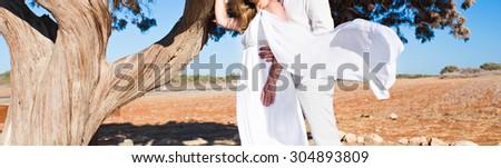 Honeymoon couple romantic in love. Newlywed happy young couple - stock photo