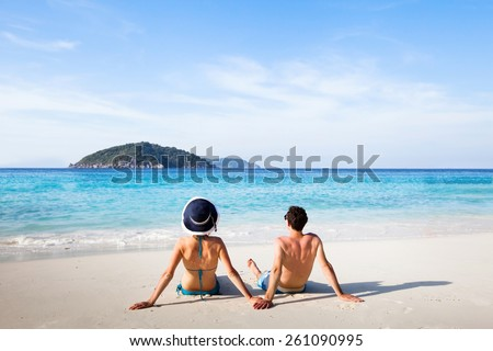 honeymoon destination, young happy couple relaxing on paradise beach - stock photo