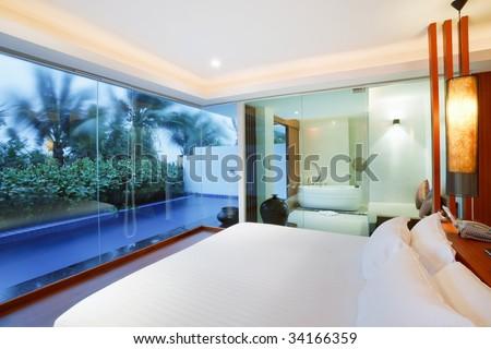 honeymoon sweet bedroom with swimming pool - stock photo