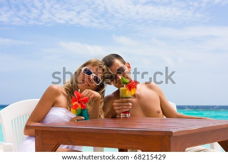 honeymoon with cocktails on a tropical beach - stock photo
