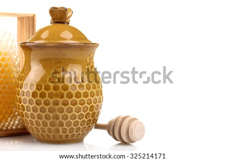 honeypot and spoon for honey near honey combs on white isolated background - stock photo
