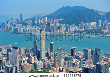 Hong Kong aerial view panorama with urban skyscrapers and sea.