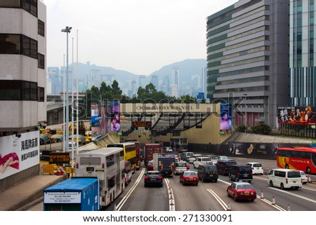 HONG KONG - APR 14, 2014: Entrance of the Hong Kong Cross-harbour Tunnel in Kowloon, Hong Kong. This is the first tunnel in Hong Kong built underwater. - stock photo