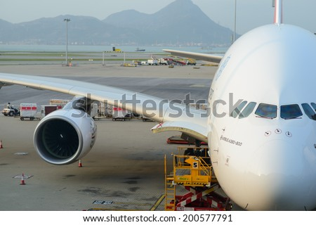 HONG KONG - APRIL 17: Emirates A380-800 docked in Airport on April 17, 2014 in Hong Kong. Hong Kong International Airport  is one of the best airport in the annual passenger survey by Skytrax.  - stock photo