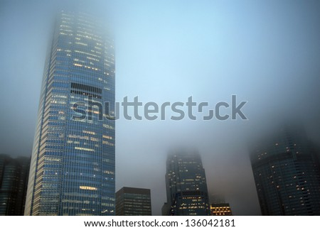 HONG KONG - APRIL 19: futuristic skyscrapers ifc exterior cover by fog, sky can't be seen on April 19, 2013 in hongkong. Troughs of low pressure cause mists and fog over Hong Kong in spring weather