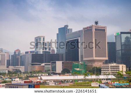 HONG KONG - APRIl 16, 2014: Hong Kong skyline with tall skyscrapers. The city is a major tourist attraction with more than 30 million visitors every year. - stock photo