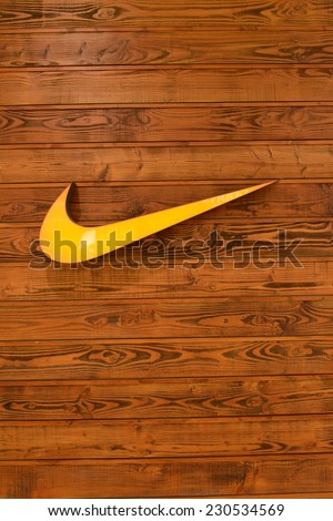HONG KONG - APRIL 02: Nike, Inc. logo on wooden wall on April 02, 2014 in Hong Kong. The company was founded on January 25, 1964, as Blue Ribbon Sports, by Bill Bowerman and Phil Knight - stock photo