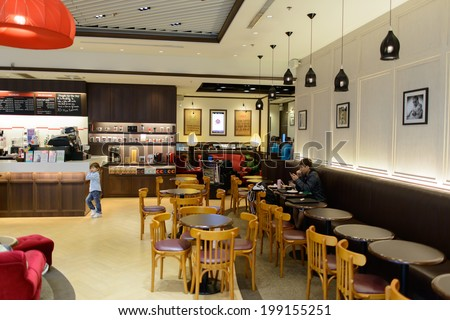 HONG KONG - APRIL 01: Pacific Coffee cafe in airport on April 01, 2014 in Hong Kong, China. Pacific Coffee Company is a Pacific Northwest U.S.-style coffee shop group originating from Hong Kong. - stock photo