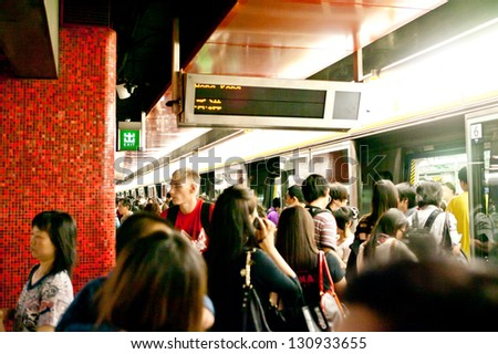 HONG KONG - APRIL 10: People waiting train  MTR underground in the Hong Kong on April 10 2011. Mass Transit Railway is rapid system in Hong Kong that is a common mode of public transport. - stock photo