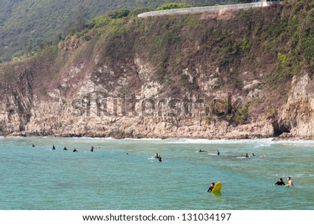 "HONG KONG - APRIL 10: Tai Long Wan beach ""Big Wave Bay"" in Hong Kong on April 10 2011. Considered one of the most beautiful places in Hong Kong, it is a popular surf destination."