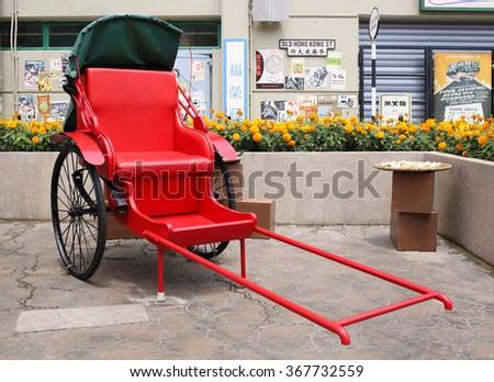 HONG KONG - APRIL 5, 2015: Traditional Chinese Rickshaw on April 5, 2015 in Hong Kong. - stock photo