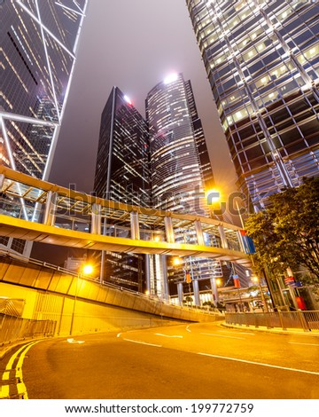 Hong Kong at night with highrise buildings - stock photo