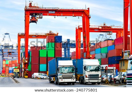 HONG KONG -Aug14: Containers at Hong Kong commercial port on Aug14, 2013 in Hong Kong, China. Hong Kong is one of several hub ports serving more than 240 million tonnes of cargo during the year. - stock photo