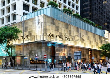 HONG KONG - AUG 8 : Exterior of a Louis Vuitton store in Hong Kong on May 8 , 2015. The Louis Vuitton company operates in 50 countries with more than 460 stores worldwide. - stock photo