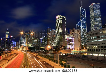 HONG KONG - AUGUST 2: Hong Kong skyline and traffic at night on August 2, 2010 in Hong Kong. This city is renowned because is one of the World's leading international financial centres. - stock photo