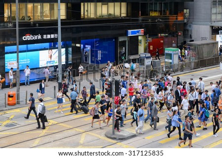 HONG KONG - AUGUST 24, 2015 - In the Streets of Hong Kong. Hong Kong became a colony of the British Empire after the First Opium War. - stock photo