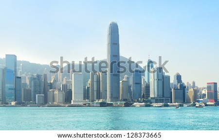 Hong Kong business center with a clear blue sky - stock photo