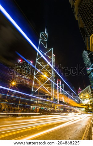 Hong Kong Business District at Night with Light Track - stock photo