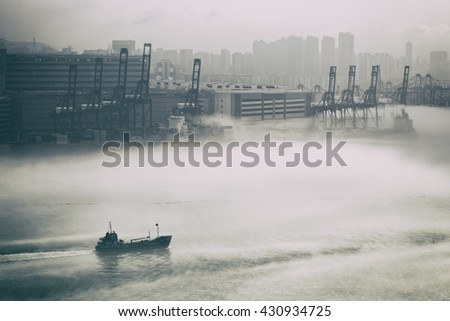 Hong Kong cargo port in mist - stock photo