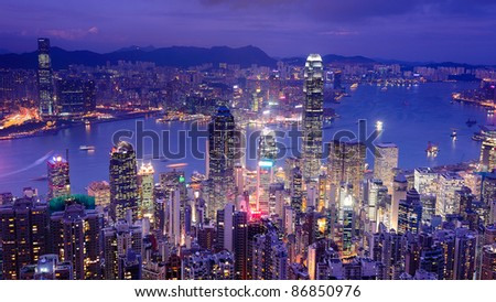 Hong Kong central district Victoria Harbour skyline at night aerial - stock photo