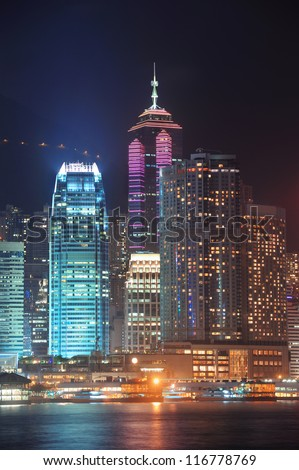 HONG KONG, CHINA - APR 23: Crowded city view at night on April 23, 2012 in Hong Kong, China. With 7M population and land mass of 1104 sq km, it is one of the most dense areas in the world. - stock photo