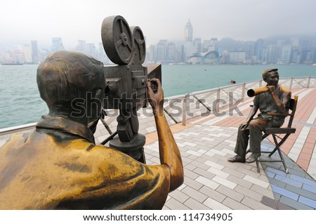 HONG KONG, CHINA - APR 17: Statue and skyline in Avenue of Stars on April 17, 2012 in Hong Kong, China. The promenade honours celebrities of the Hong Kong film industry as the famous city attraction. - stock photo