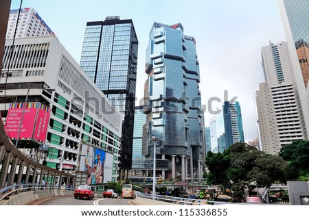 HONG KONG, CHINA - APR 23: Street view with traffic on April 23, 2012 in Hong Kong, China. With 7M population and land mass of 1104 sq km, it is one of the most dense areas in the world. - stock photo
