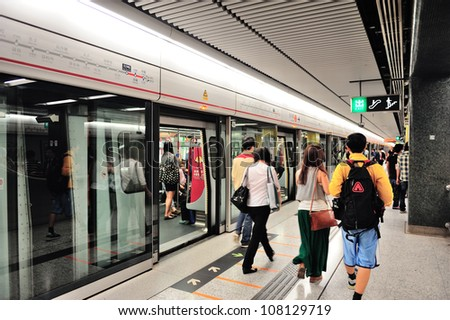 HONG KONG, CHINA - APR 23: Subway station interior on April 23, 2012 in Hong Kong, China. Over 90% daily travelers use public transportation rank Hong Kong the highest in the world. - stock photo