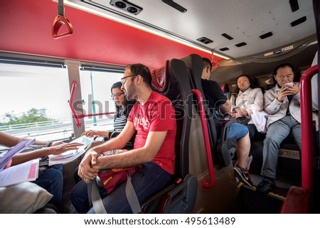 HONG KONG, CHINA - DECEMBER 1, 2015: Indian tourist traveling in local transport in Hong Kong, China on December 1, 2015