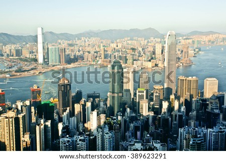 HONG KONG, CHINA - FEB 7: Cityscape of Hong Kong with waters of Victoria Harbor at sunset on February 7, 2016. More than 47 million tourists visit Hong Kong annually