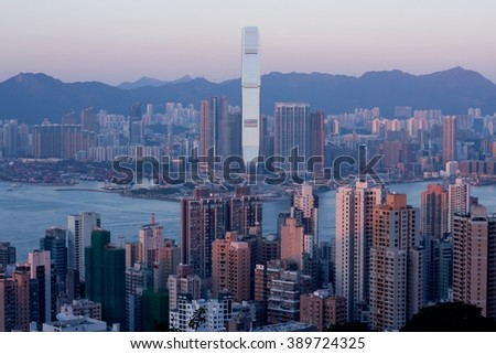 HONG KONG, CHINA - FEB 7: Cityscape of Hong Kong with waters of Victoria Harbor at sunset on February 7, 2016. There are 1,223 skyscrapers in Hong Kong. - stock photo